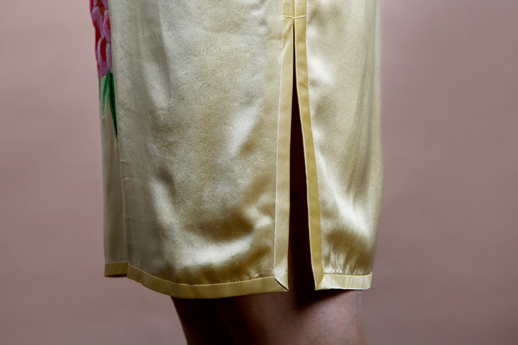 Light golden cheongsam with peonys embroidery