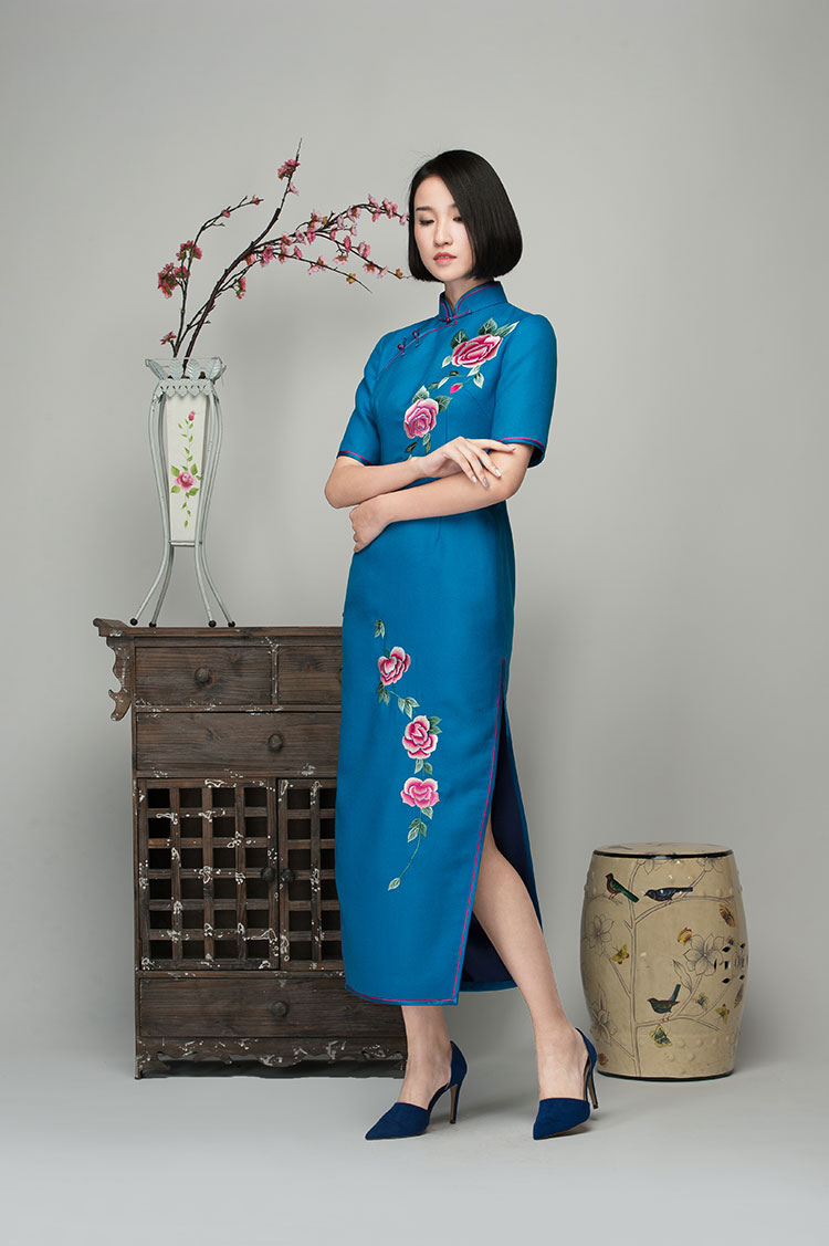 Lake blue cashmere dress with embroidered roses