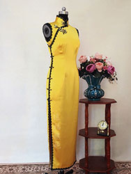 Yellow long qipao dress with black trim